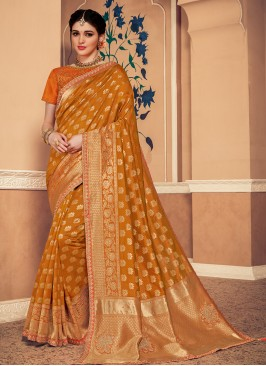 Banarasi Silk Festive Wear Designer Saree In Mustard Color
