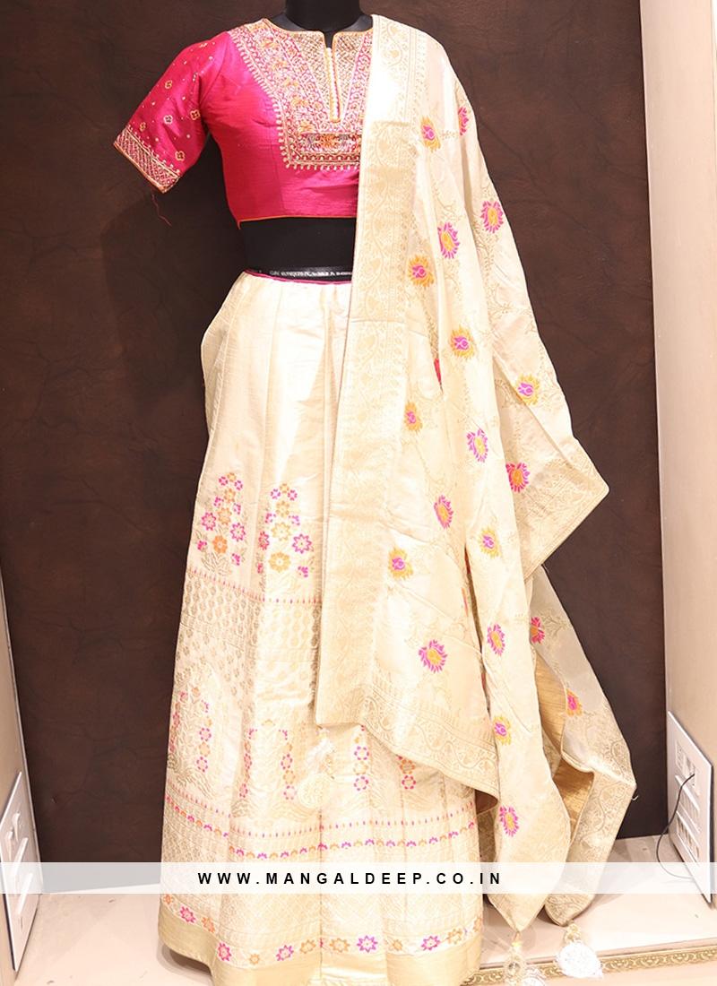 Dazzling Cream Color Heavy Lehenga Choli In Silk
