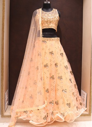 Dazzling Peach Color Heavy Lehenga Choli In Net