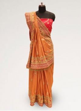 Graceful Orange Color Function Wear Silk Saree