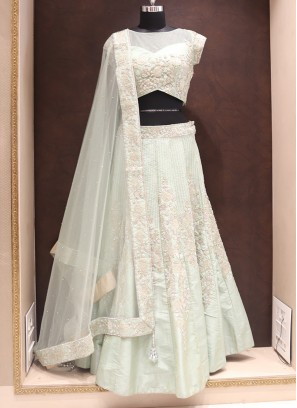Party Wear Attractive Net And Raw Silk Lehenga Choli In Green Color