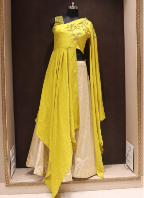 Party Wear Attractive Silk Lehenga Choli In Yellow And Cream Color